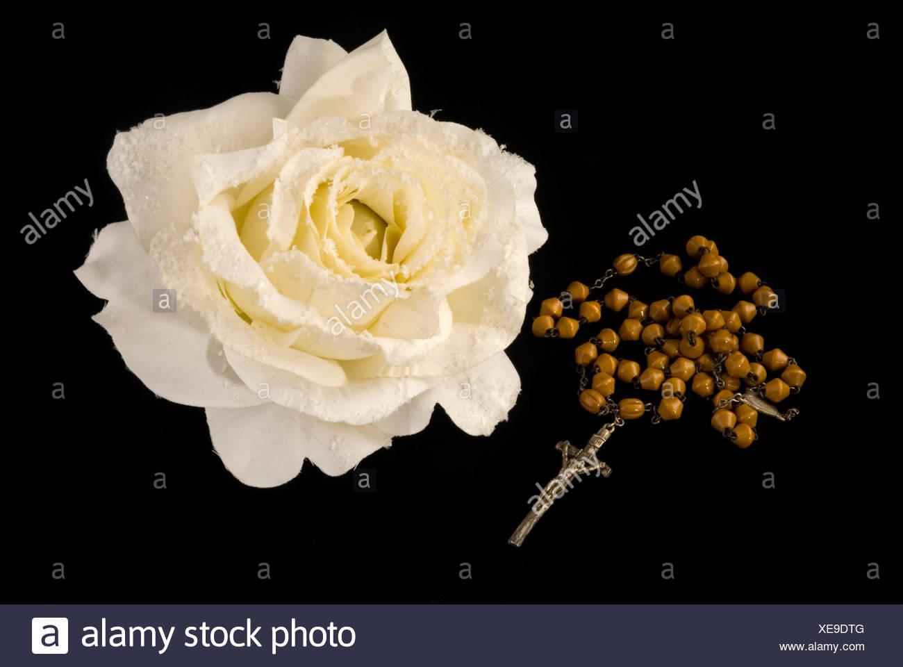 Rosary and rose stock photo 284179520 alamy rosary and rose izmirmasajfo