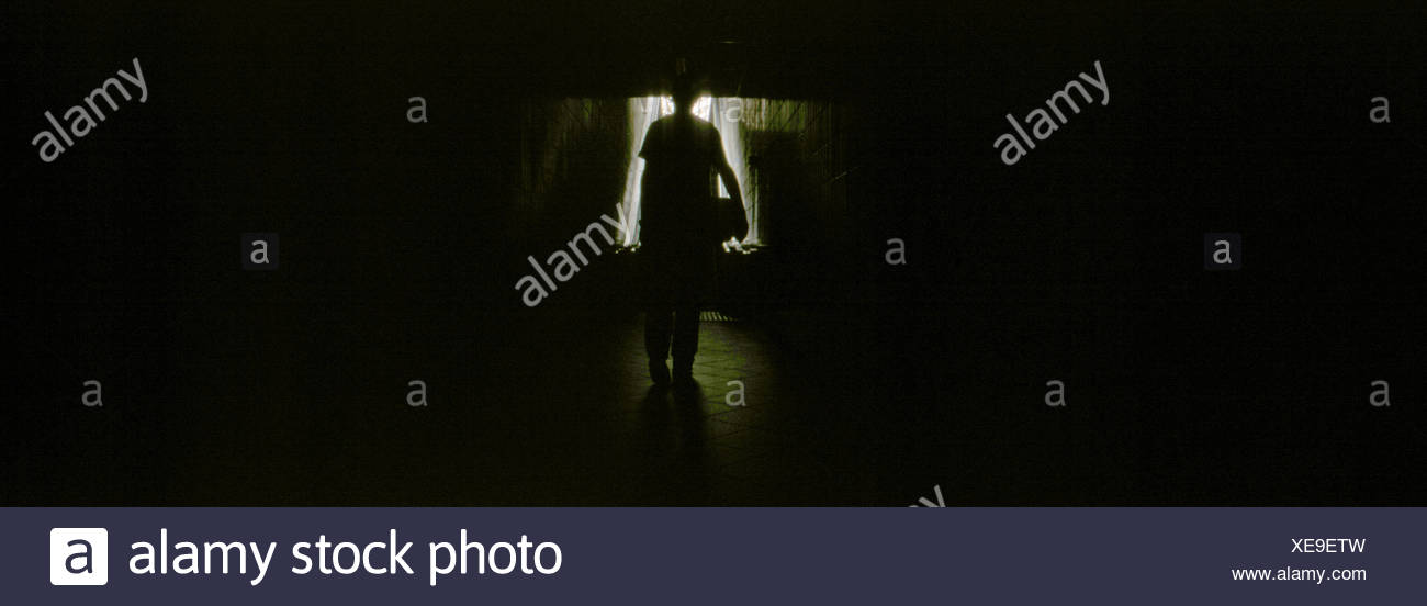 Silhouette Person In Darkroom - Stock Image
