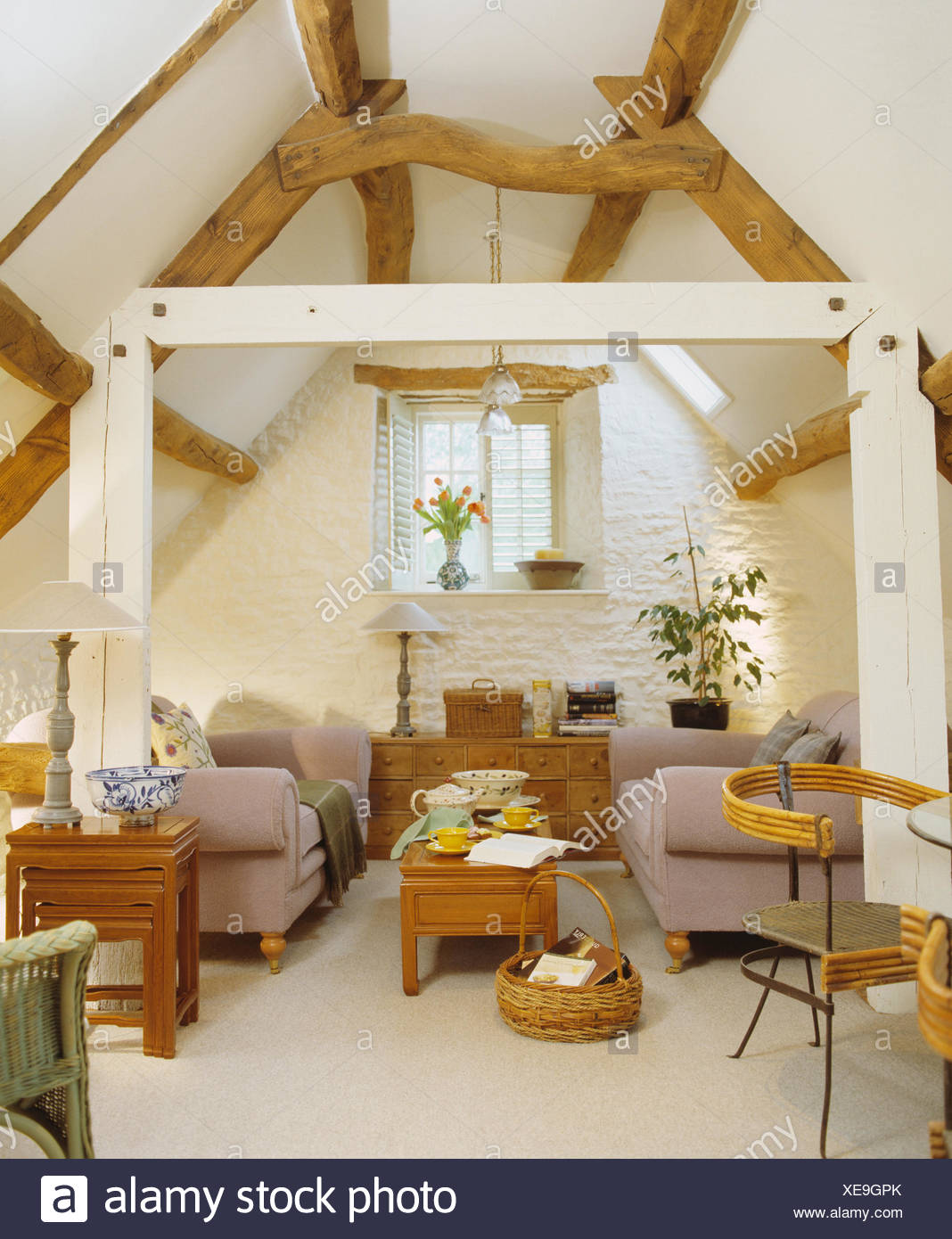 Old Oak Beams And White Painted Support Beam In Country Loft Living