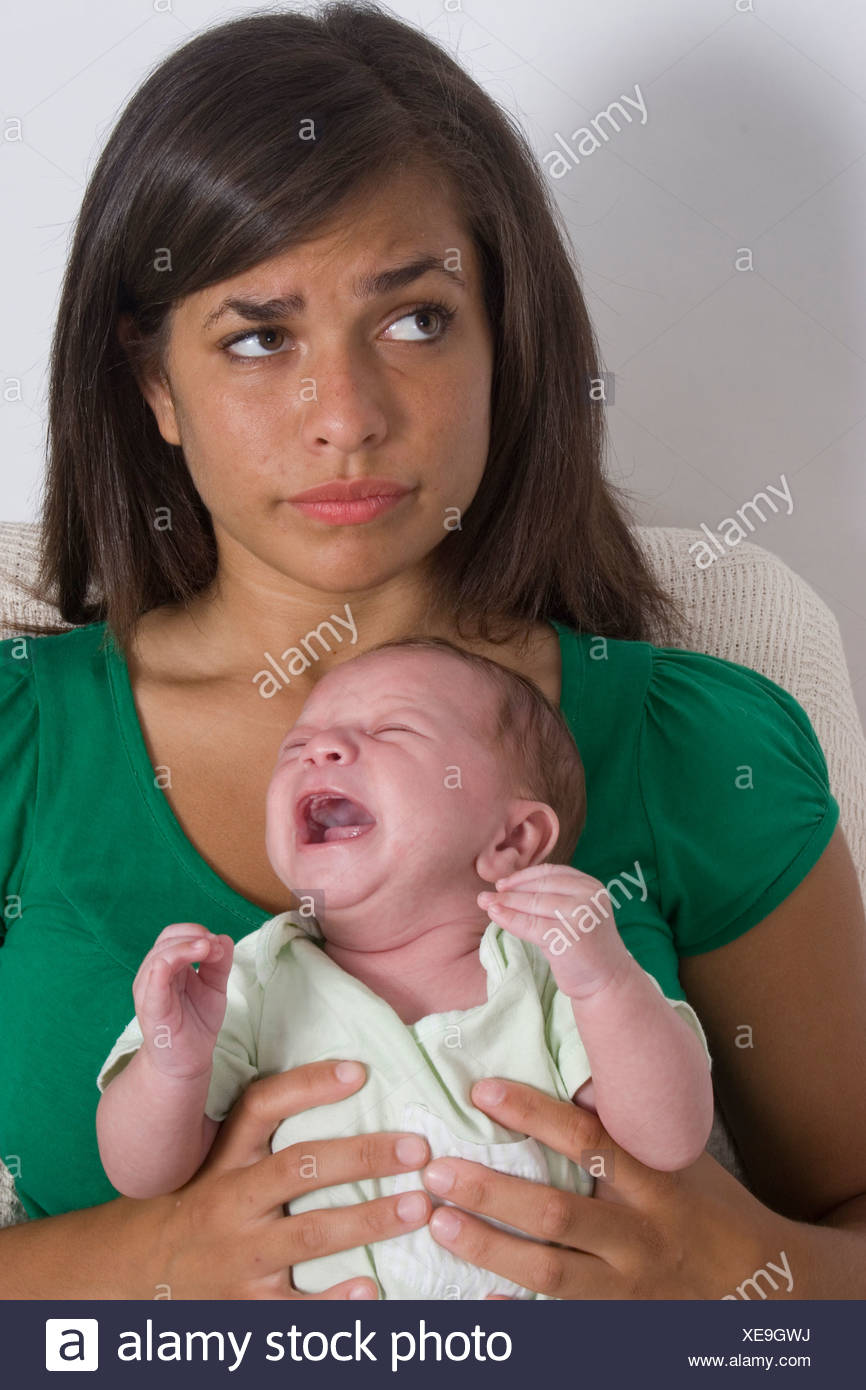 teenager mother with baby - Stock Image