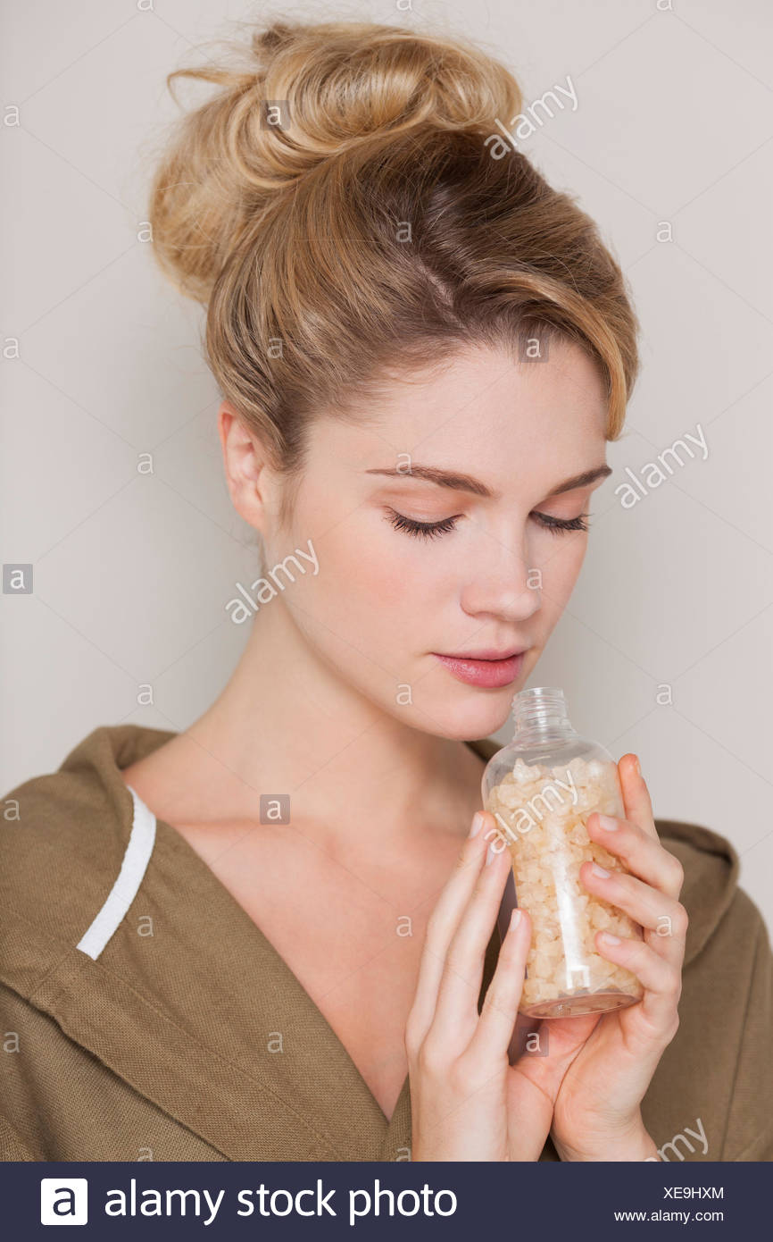 Beautiful woman smelling bath salt - Stock Image