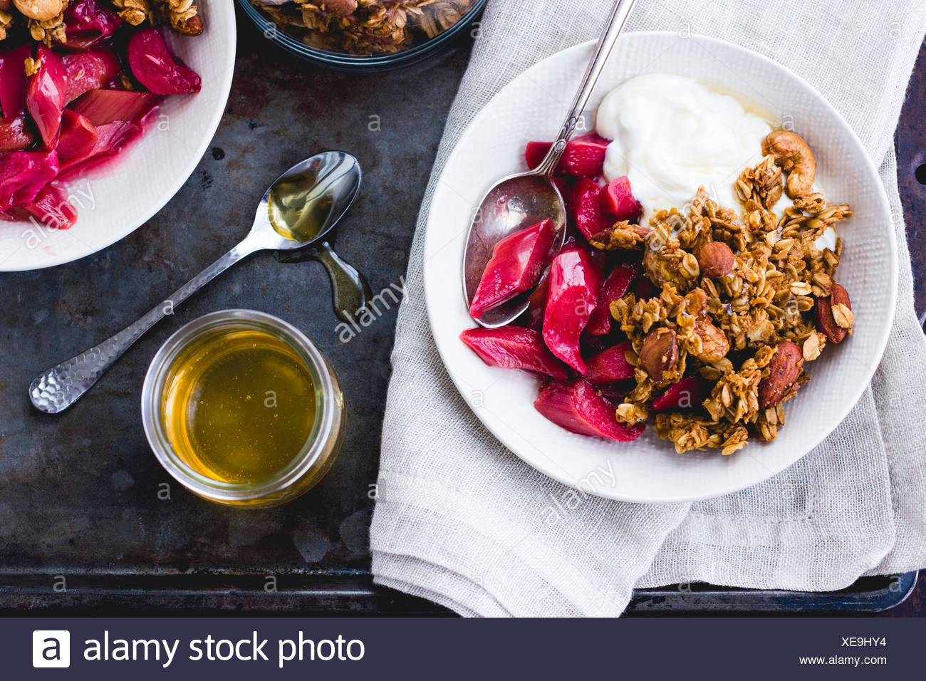 Poached rhubarb and honey, yoghurt and granola breakfast - Stock Image