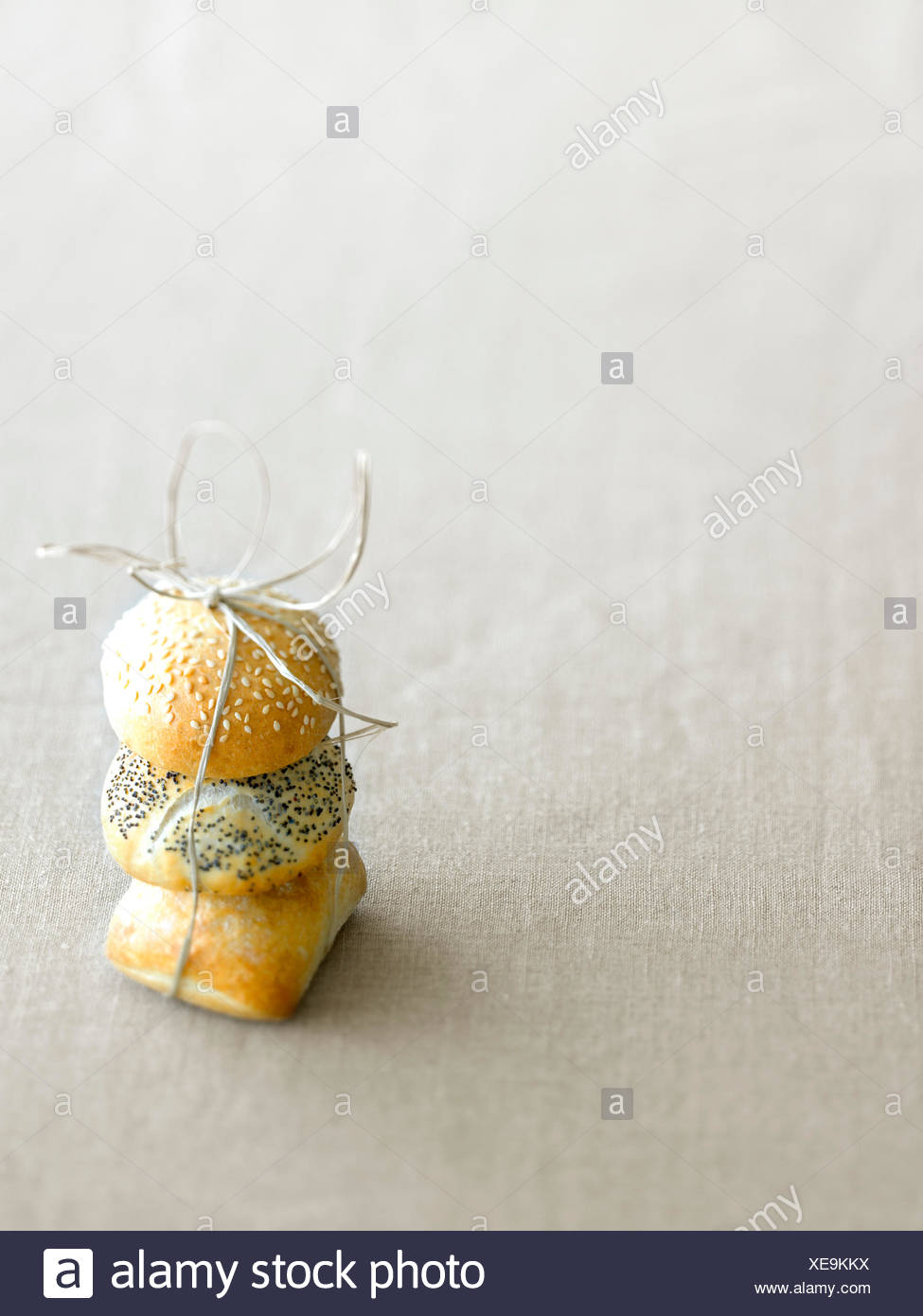 Three little breads tied together - Stock Image