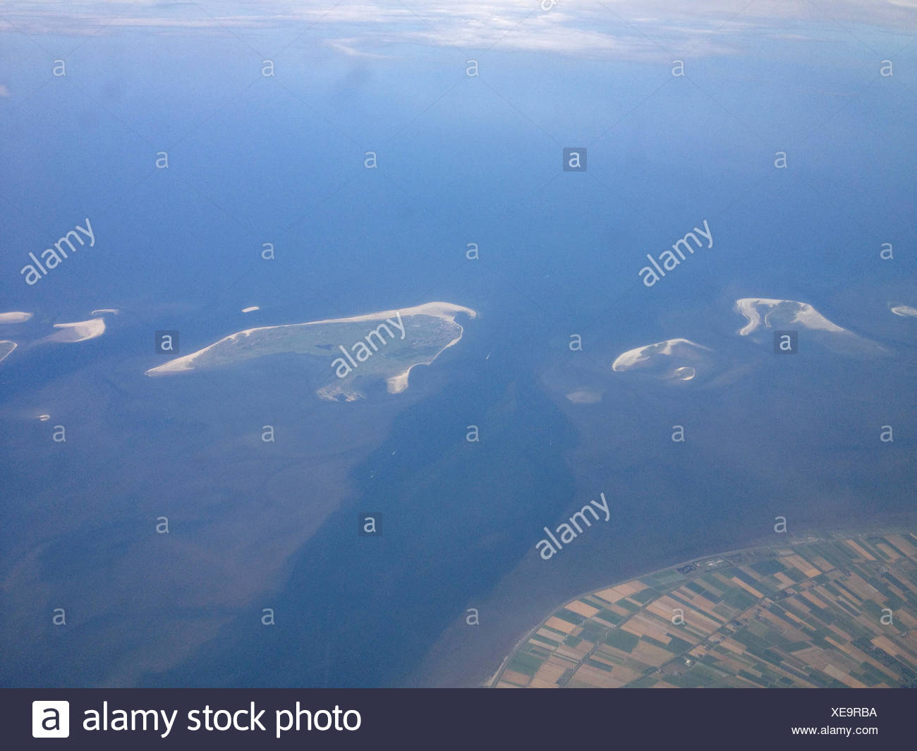 Denmark, Sand flats and agricultural coastline - Stock Image