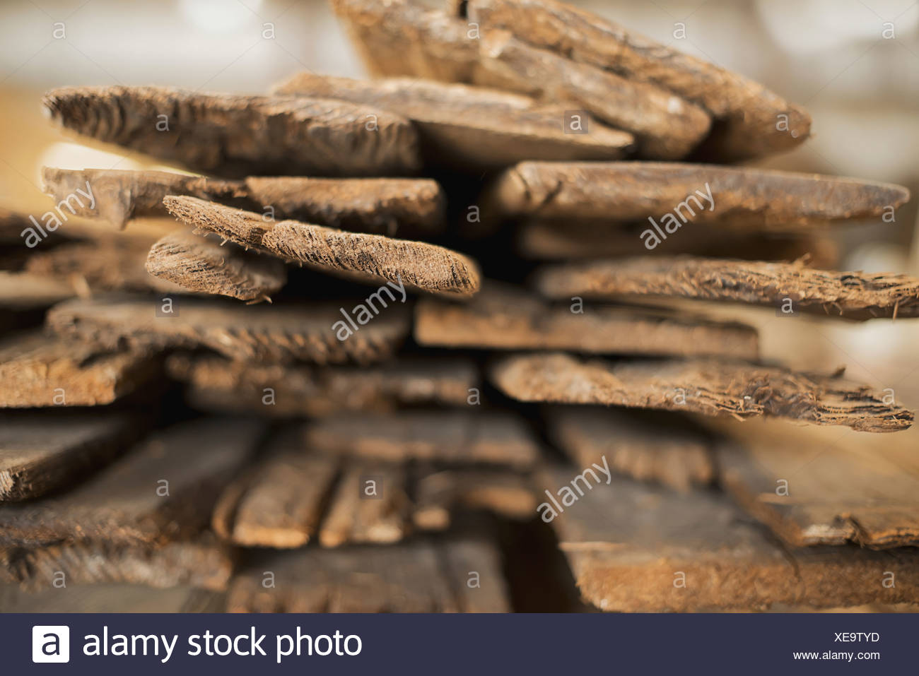 A heap of recycled reclaimed timber planks of wood Environmentally responsible reclamation in a timber yard - Stock Image