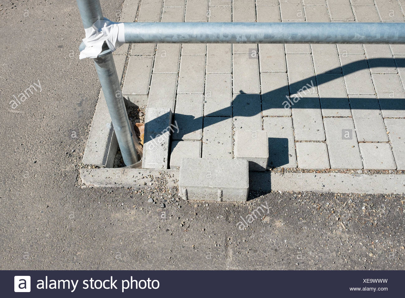 railings made of steel anchored in concrete paving stone - Stock Image