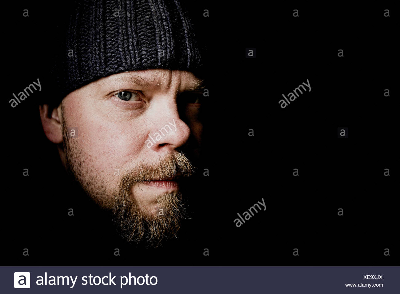 Portrait of professionel flyfisherman Mattias Drugge, Sweden. He is wearing a black hat and has a short beard. Stock Photo