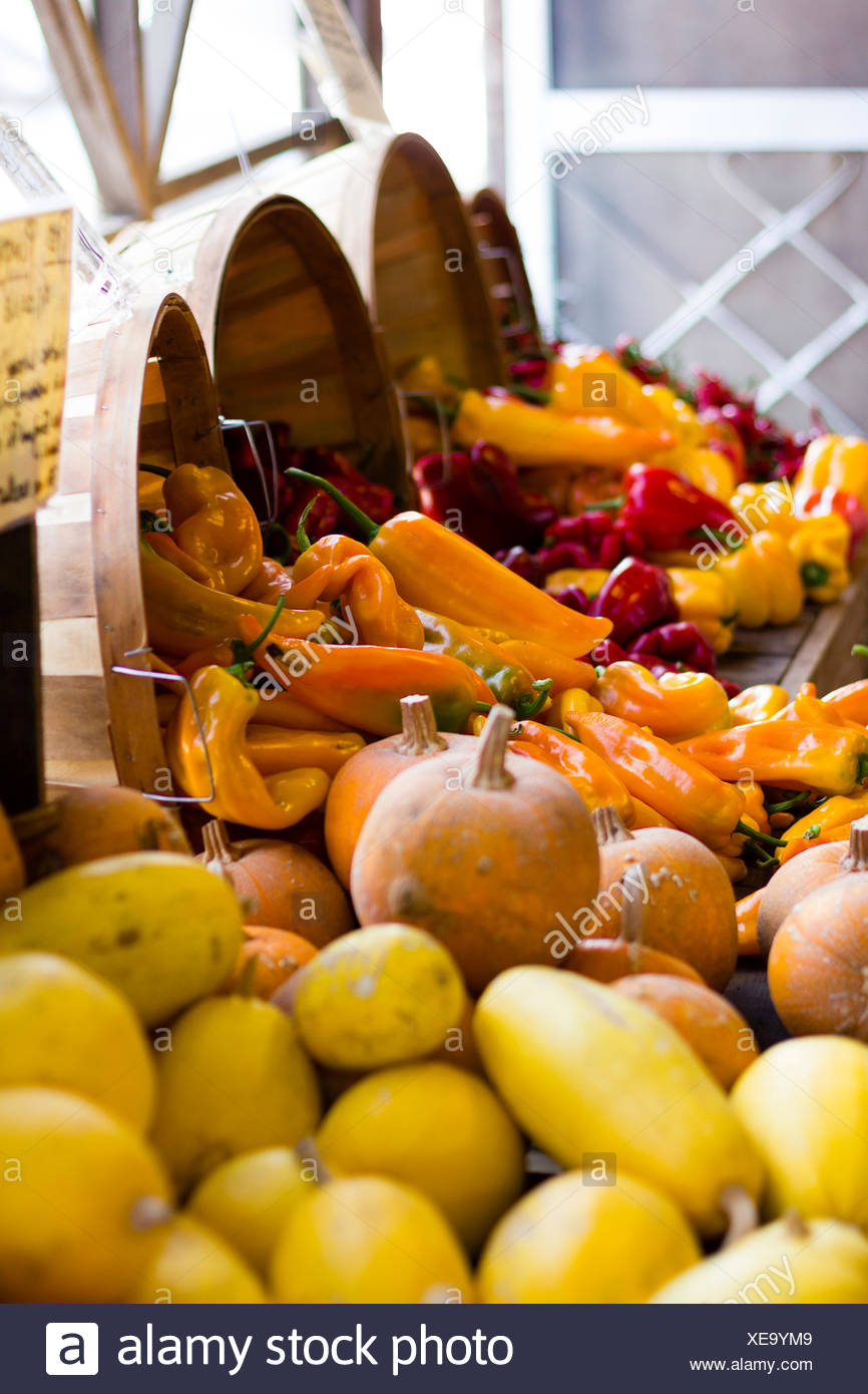 Fall produce at a farmers market. - Stock Image