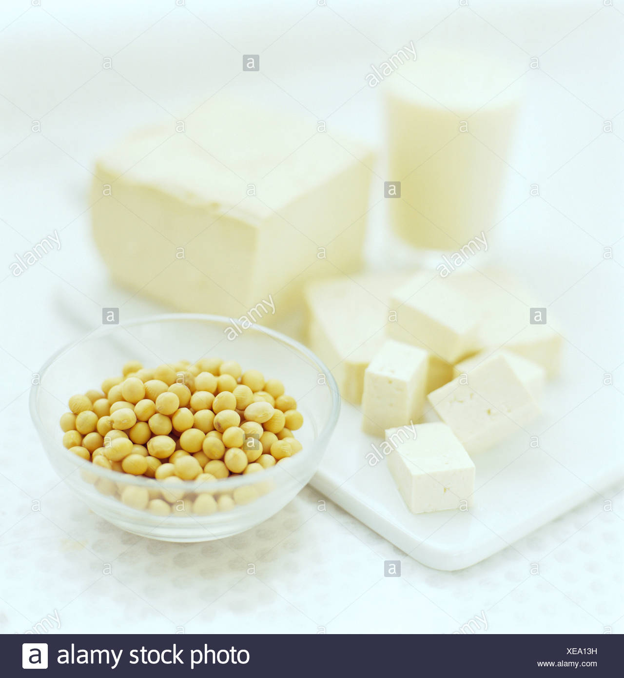 Soya bean products. Soya beans (Glycine max, lower right, in bowl) are one of the very best dietary sources of protein. - Stock Image