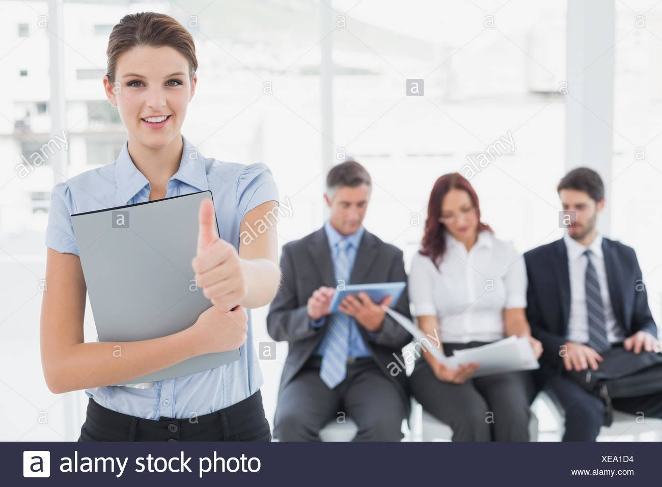 Business woman offering a handshake - Stock Image