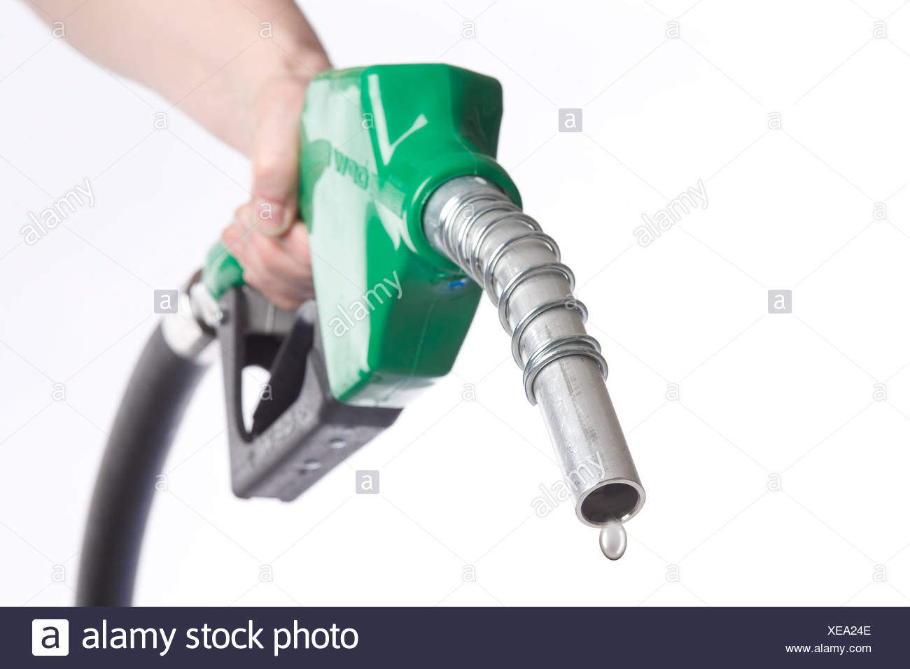 Hand holding nozzle with drop of water coming out, Winnipeg, Manitoba - Stock Image