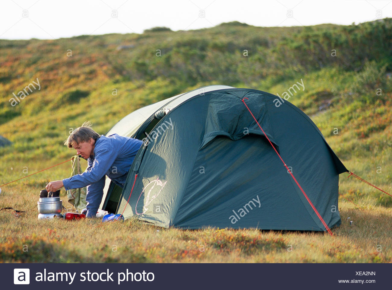 A woman camping. - Stock Image