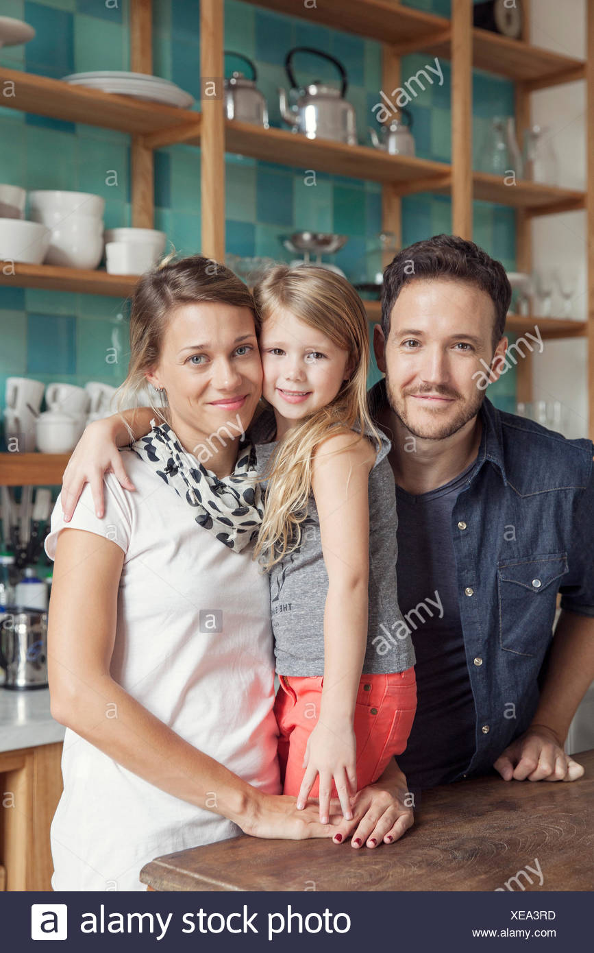 Family at home together in kitchen, portrait - Stock Image
