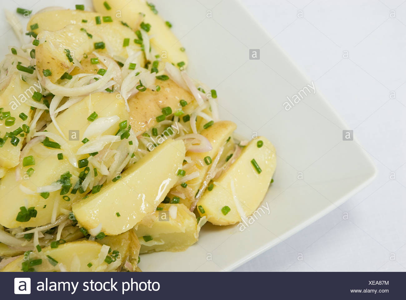 Potatoes with onions and chives - Stock Image