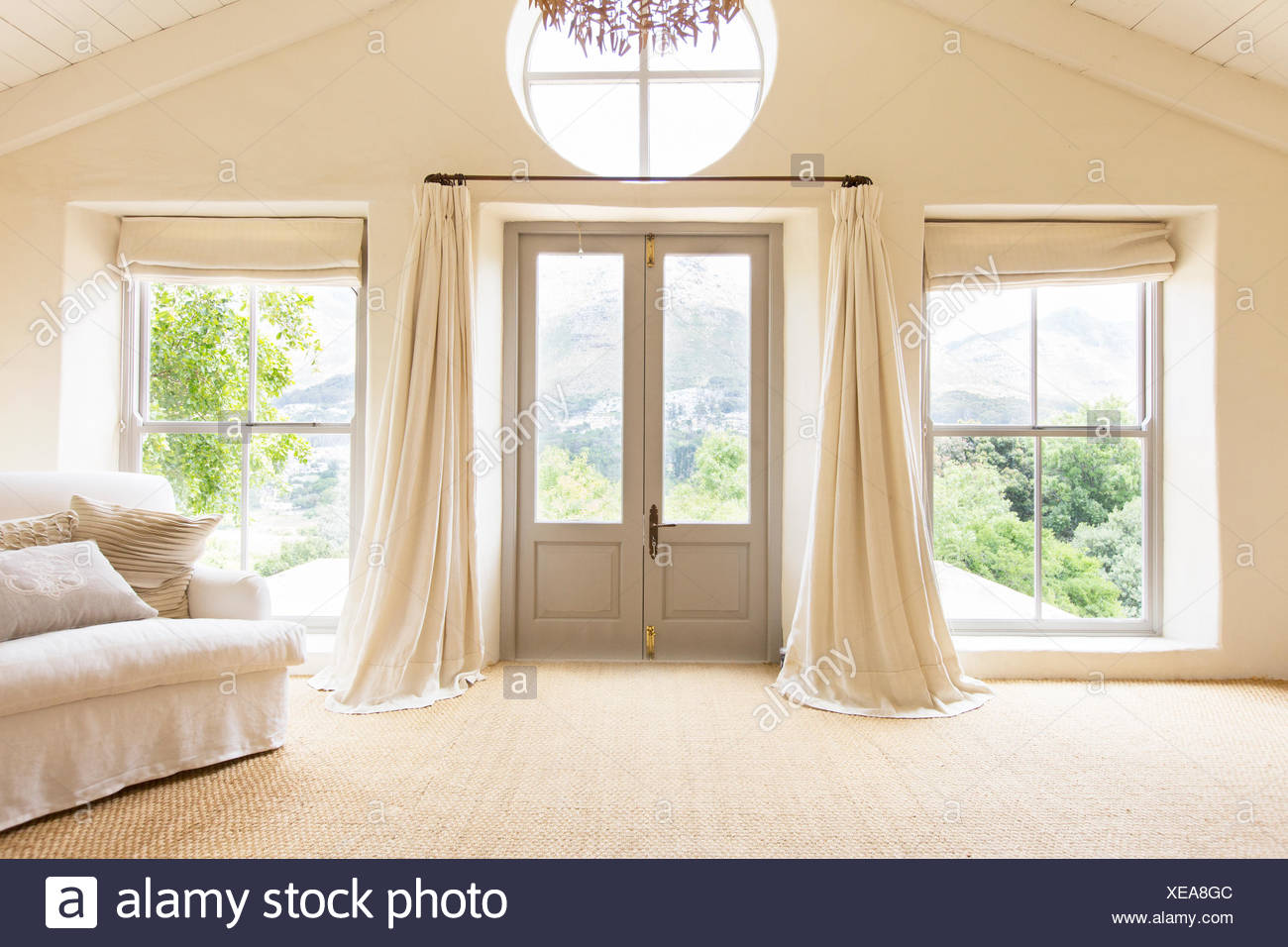 Curtains and front doors of rustic house - Stock Image
