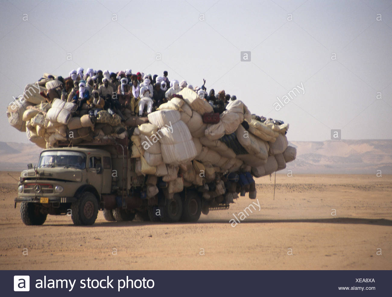 Chad, Borkou, wadi Doum, Sand runway, truck, overcrowds, Central, Africa, landlocked country, Sahara, desert, wild scenery, truck, truck, transport, promotion, costs, people, locals, florid - Stock Image