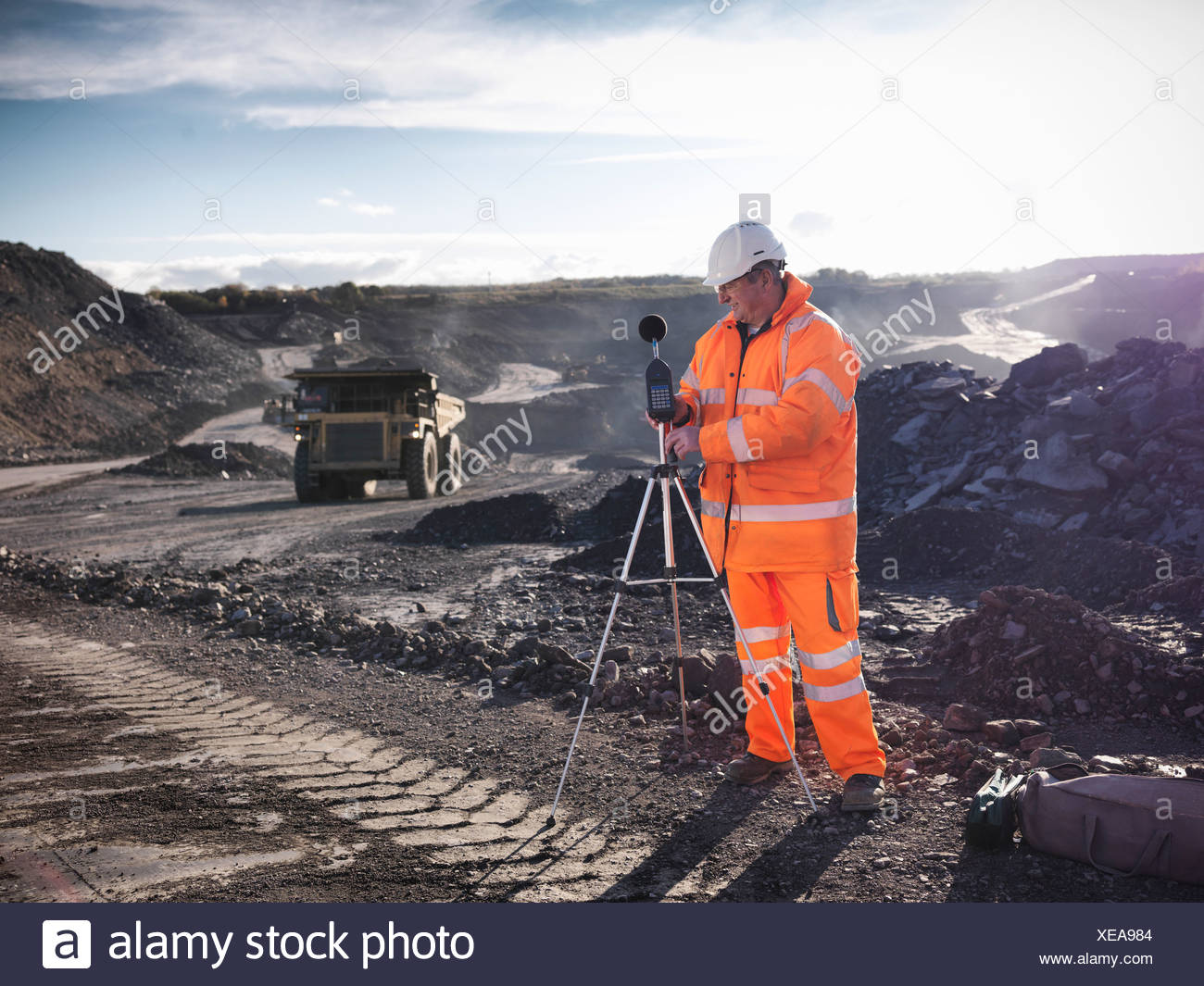 Ecologist listening to coal mine - Stock Image