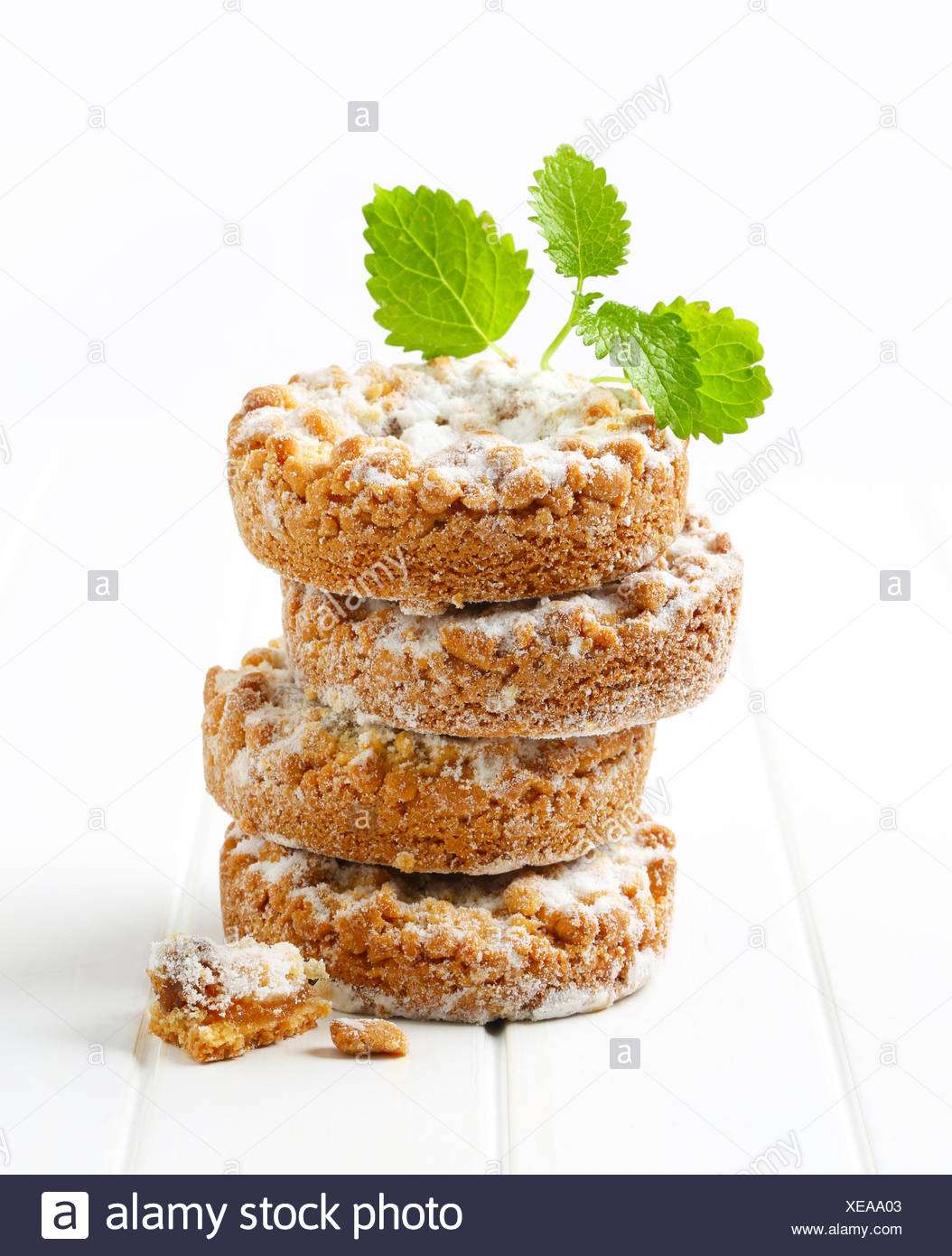 Apple crumble cookies dusted with icing sugar - Stock Image