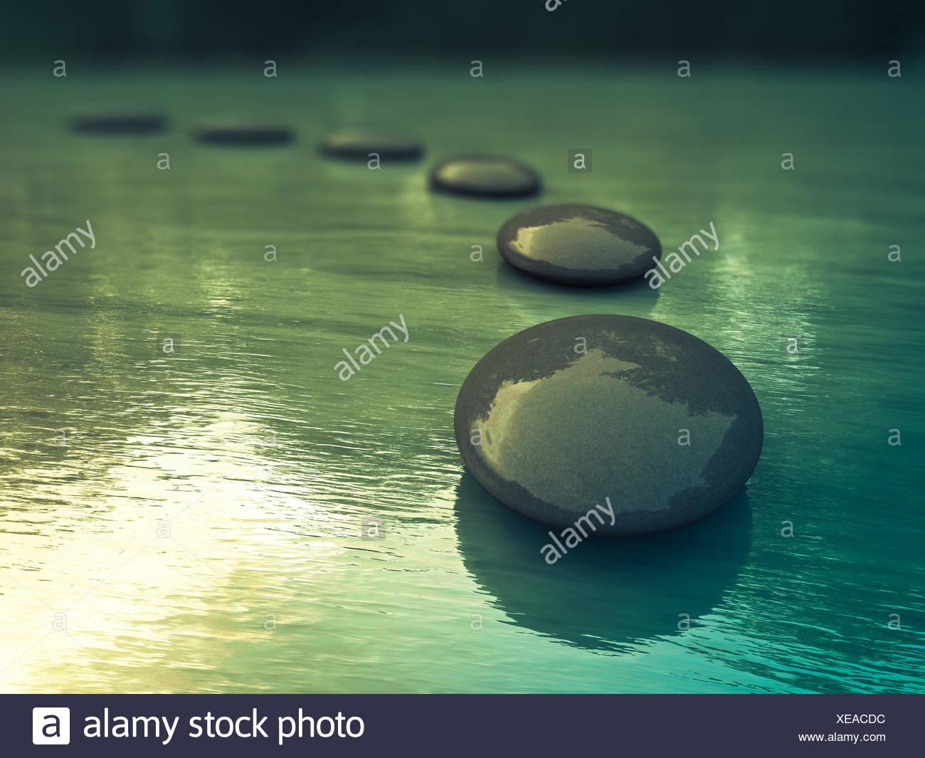 meditating,balance,basalt stone - Stock Image