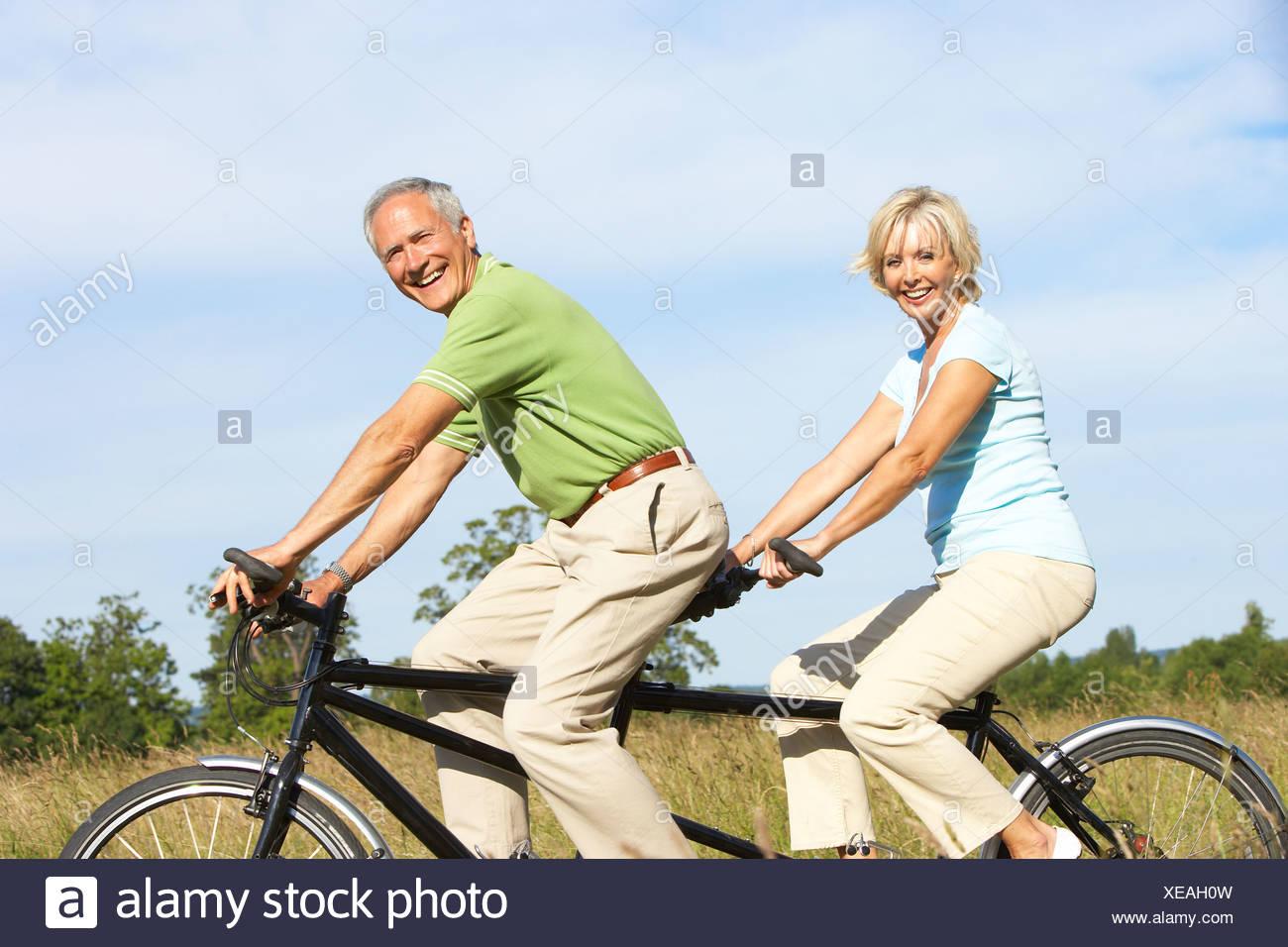 mature couple riding tandem stock photo: 284203945 - alamy