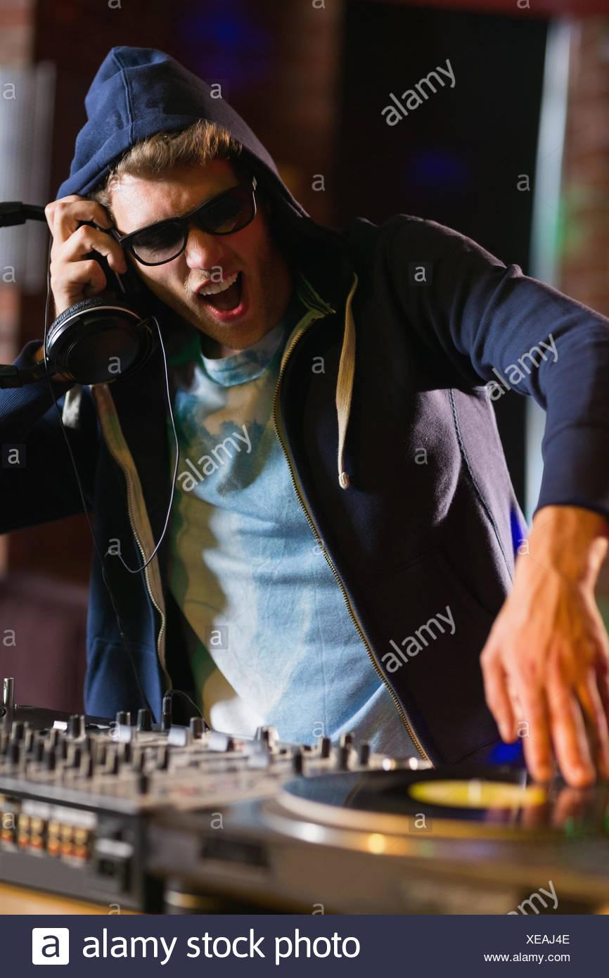 Cool dj spinning the decks - Stock Image