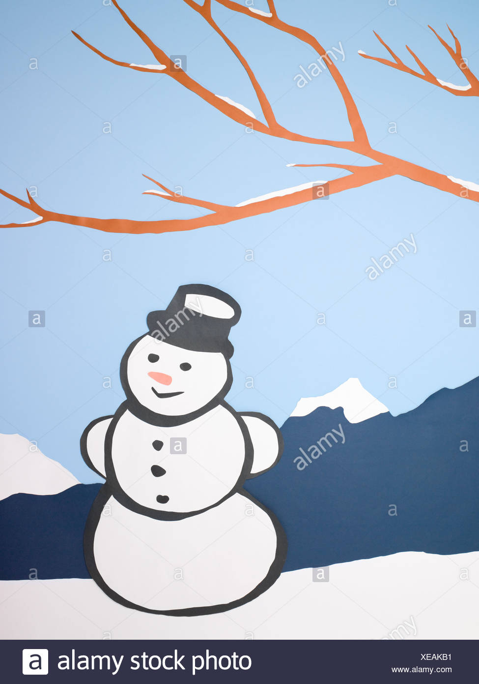 Snowman in winter scene - Stock Image