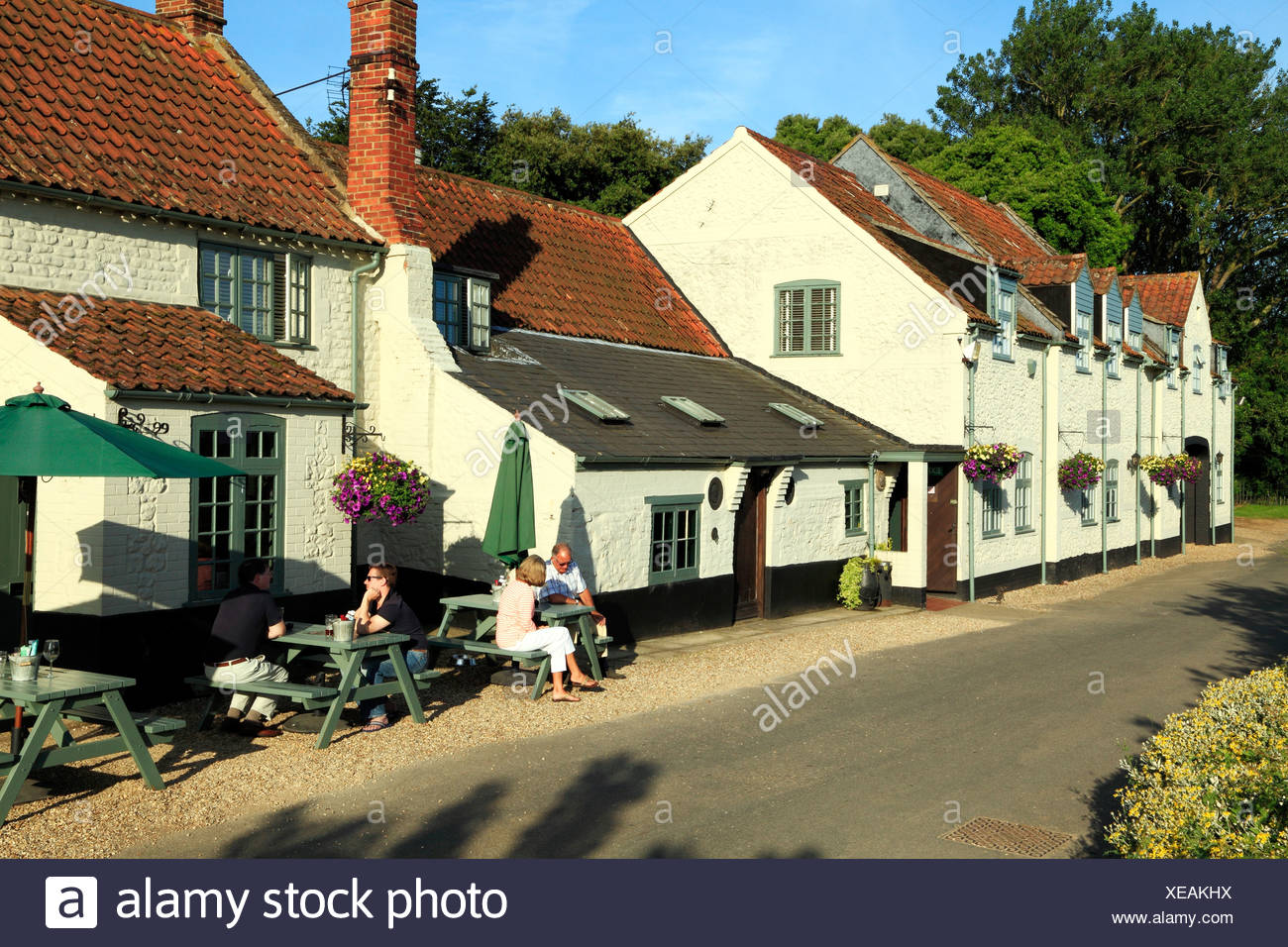 Thornham, Norfolk, The Lifeboat Inn, pub public house popular pubs inn inns England UK English country coastal people sitting - Stock Image