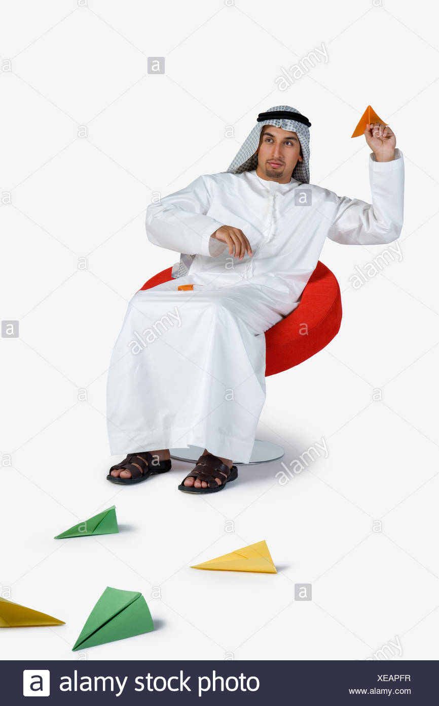Young man playing with paper planes Stock Photo