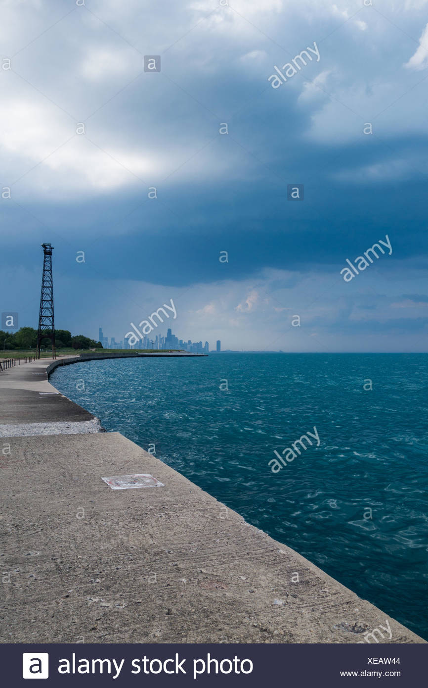 Footpath By Sea Against Cloudy Sky - Stock Image