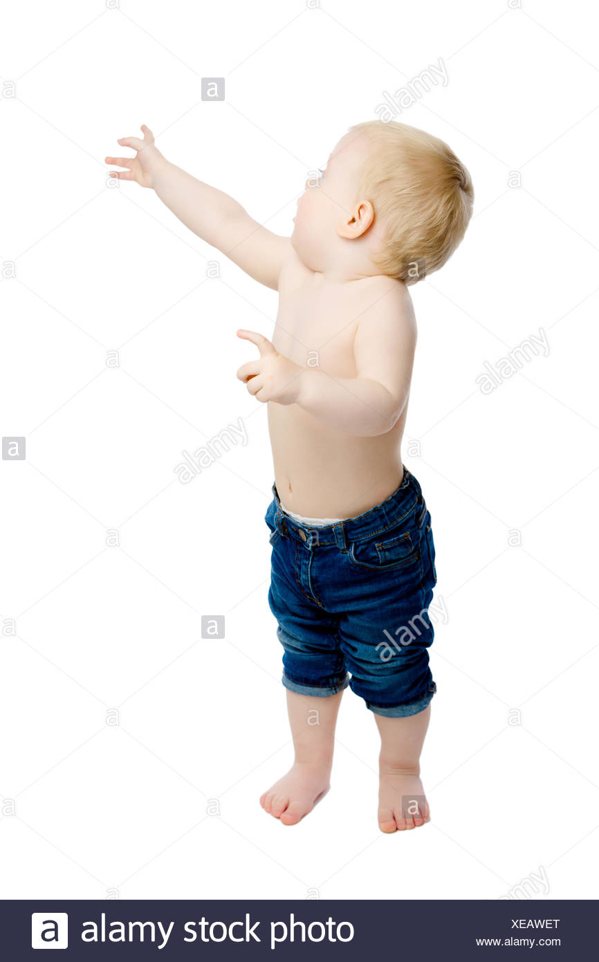little boy at the shows to something - Stock Image