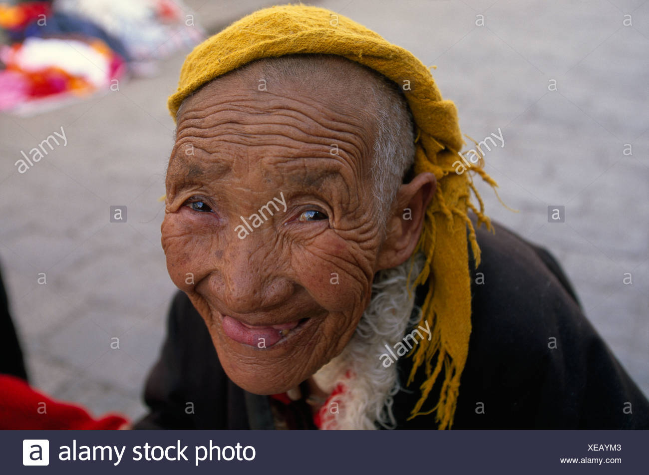 A Buddhist pilgrim smiles into the camera in Lhasa Tibet. - Stock Image