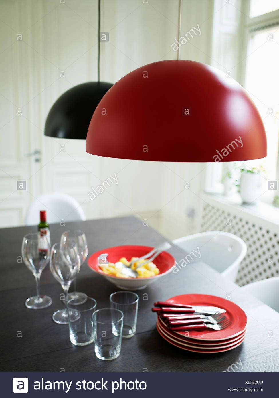 Modern design table with meal for three ready to eat - Stock Image