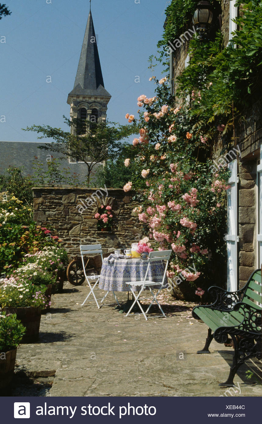 Pink climbing roses on French country house with table and chairs on on open floor plans with courtyard, french country house plans with porte cochere, duplex plans with courtyard, french country luxury house plans, french country house floor plans, french country house plans with keeping room, adobe home plans with courtyard, french country house plans one story, french country house plans designs, french country louisiana house plans, home floor plans with courtyard, french country ranch house plans, french country style house plans, french country house plans with porch, house with center courtyard, spanish home plans with courtyard, french country cottage house plans, ranch home plans with courtyard, french country house in the country, french country house plans with rear garage,