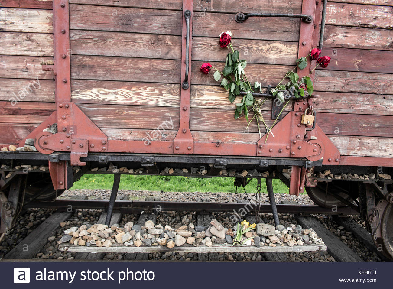 Carriage with roses, Auschwitz II-Birkenau extermination camp, Oswiecim, Poland - Stock Image