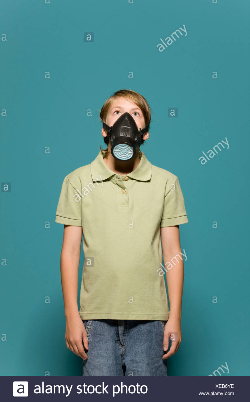 Boy wearing gas mask - Stock Image