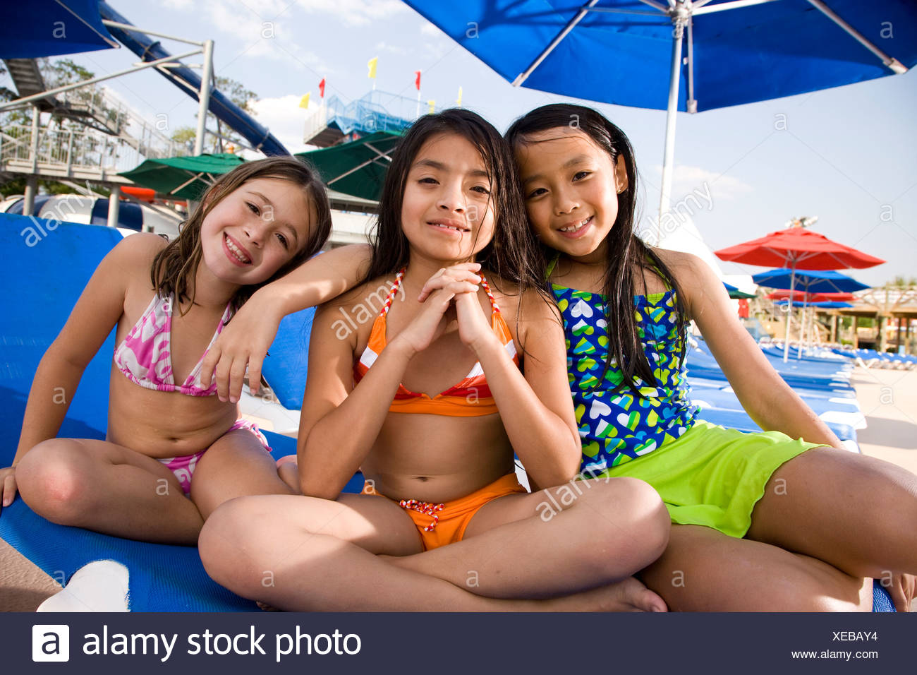 Remarkable Multi Ethnic Girls In Swimsuits Sitting On Lounge Chair In Camellatalisay Diy Chair Ideas Camellatalisaycom