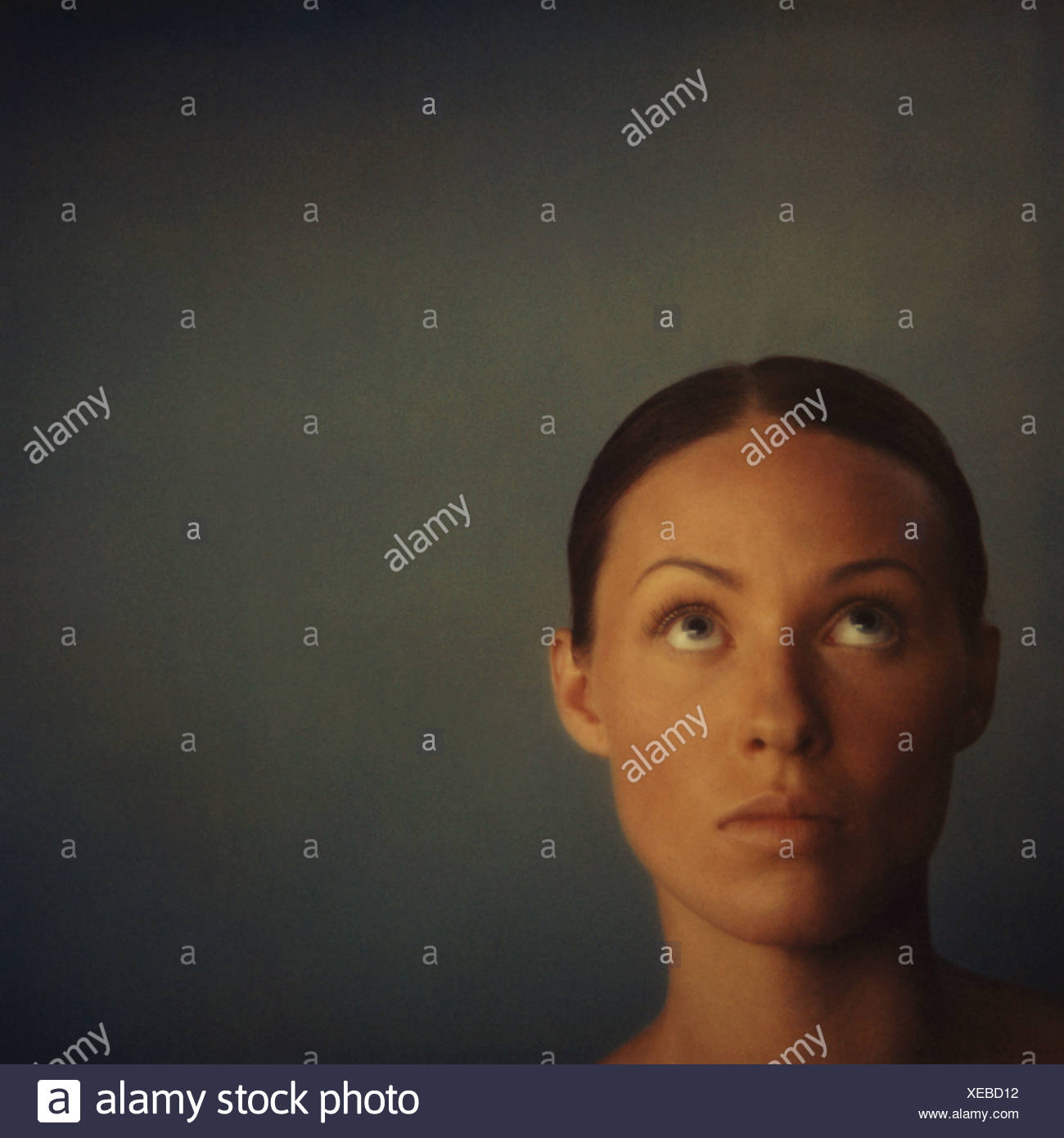 Young woman looking up, portrait Stock Photo