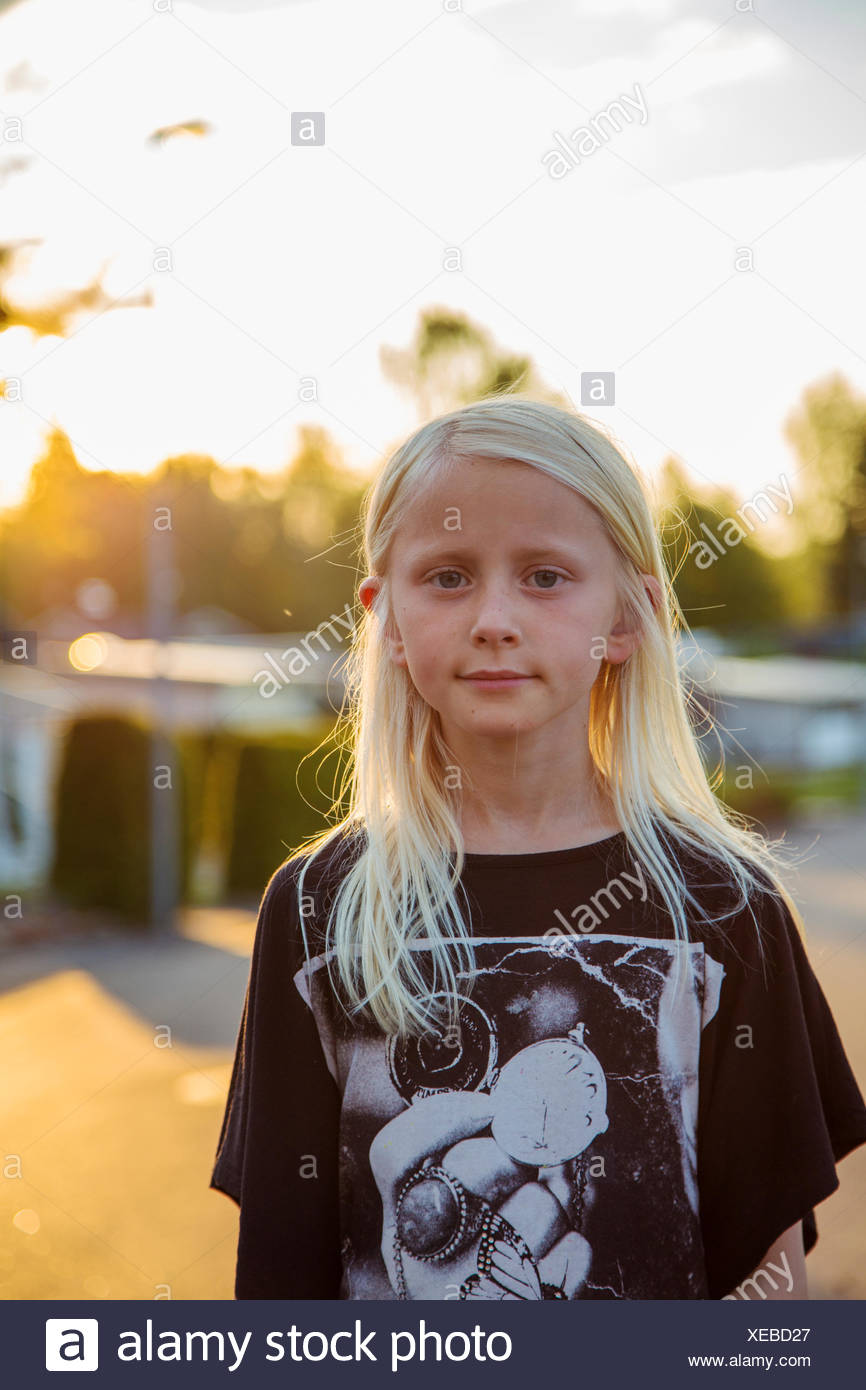 Sweden, Smaland, Anderstorp, Portrait of blond girl (10-11) - Stock Image