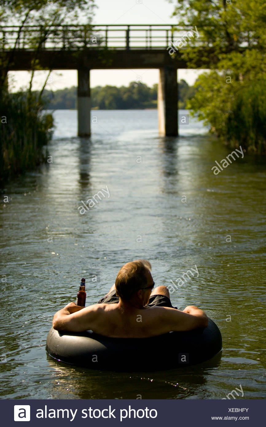 Man Floating In An Inner Tube Stock Photos Amp Man Floating