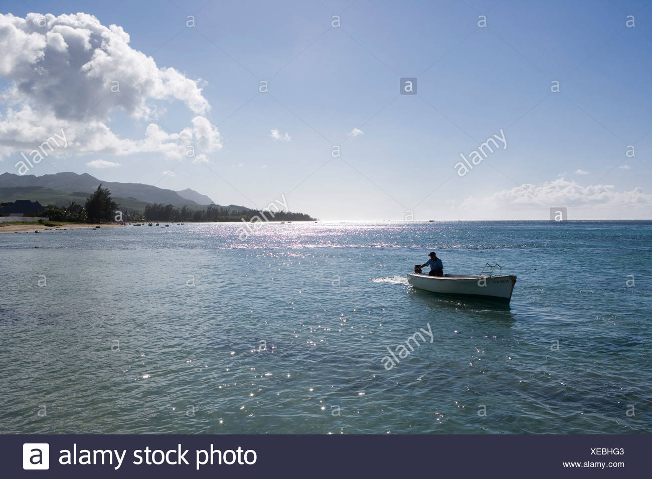 Fishing Boat and Coastline, Bel Ombre, Savanne District, Mauritius - Stock Image