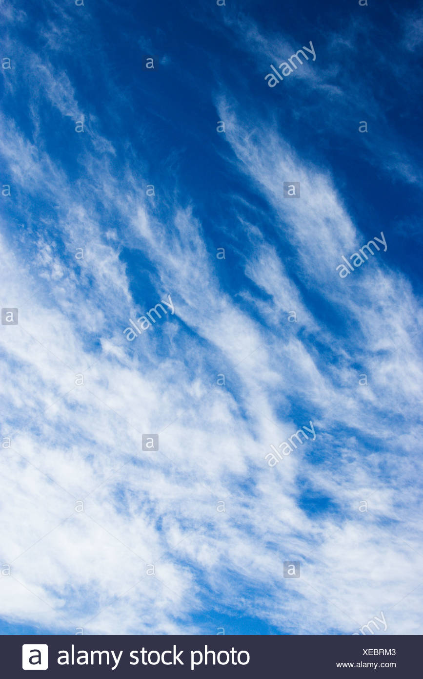 Beautiful blue sky with light wispy clouds - Stock Image