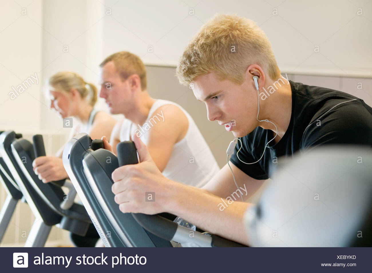 Three people working out - Stock Image