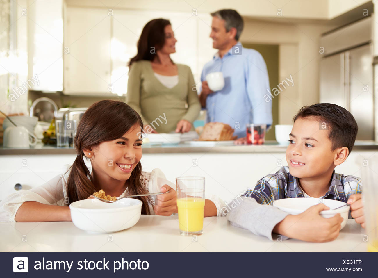 Hispanic Family Eating Breakfast At Home Together - Stock Image