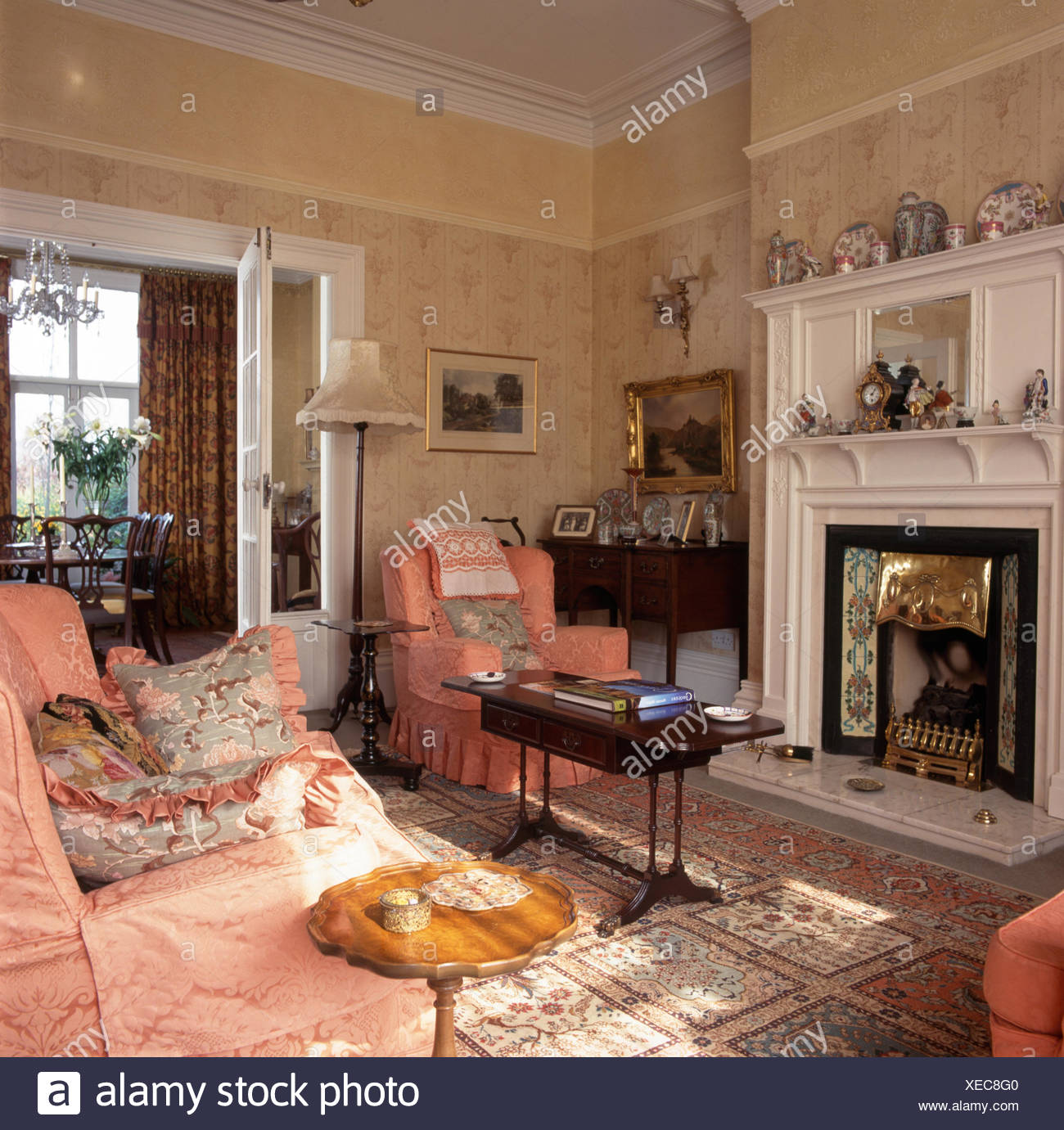 Pink damask sofa and armchair in very traditional living room Stock Photo