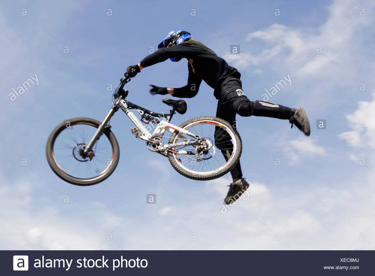 Biker performs tricky jump in the air Stock Photo