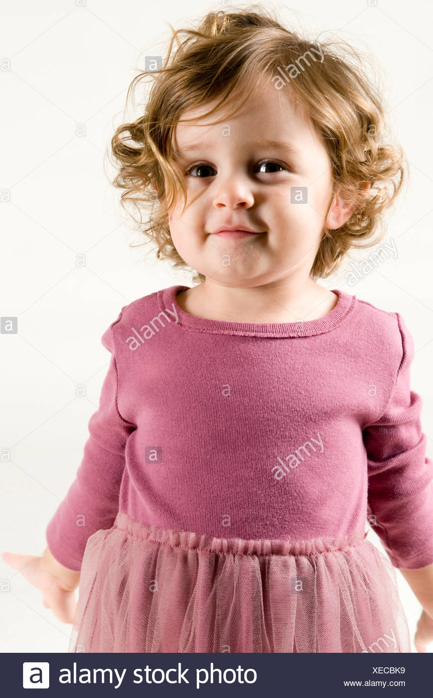 baby, purple, expression, curly, maddening, pert, coquettish, cute, girl, - Stock Image