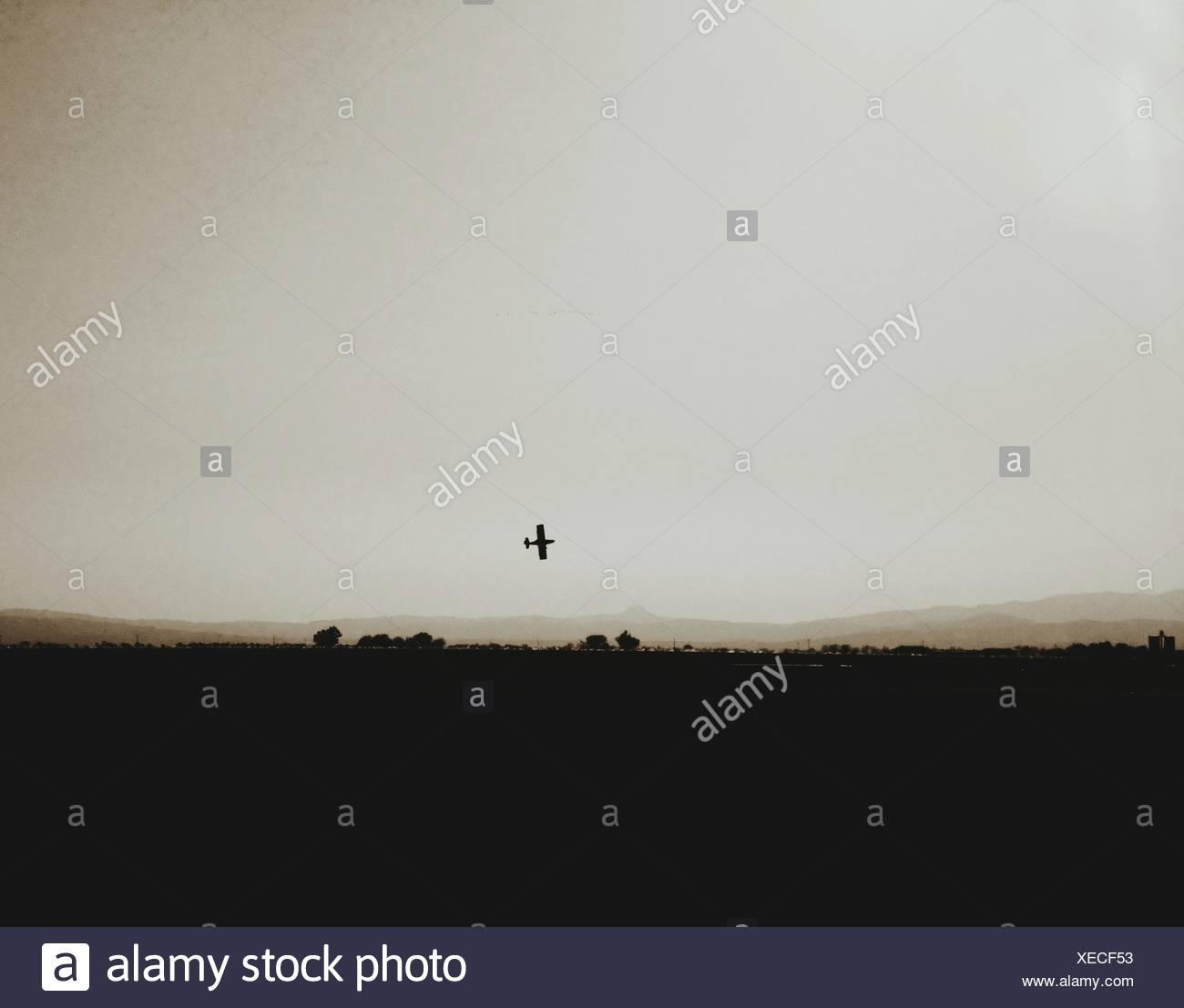 Silhouette Landscape Against Sky - Stock Image