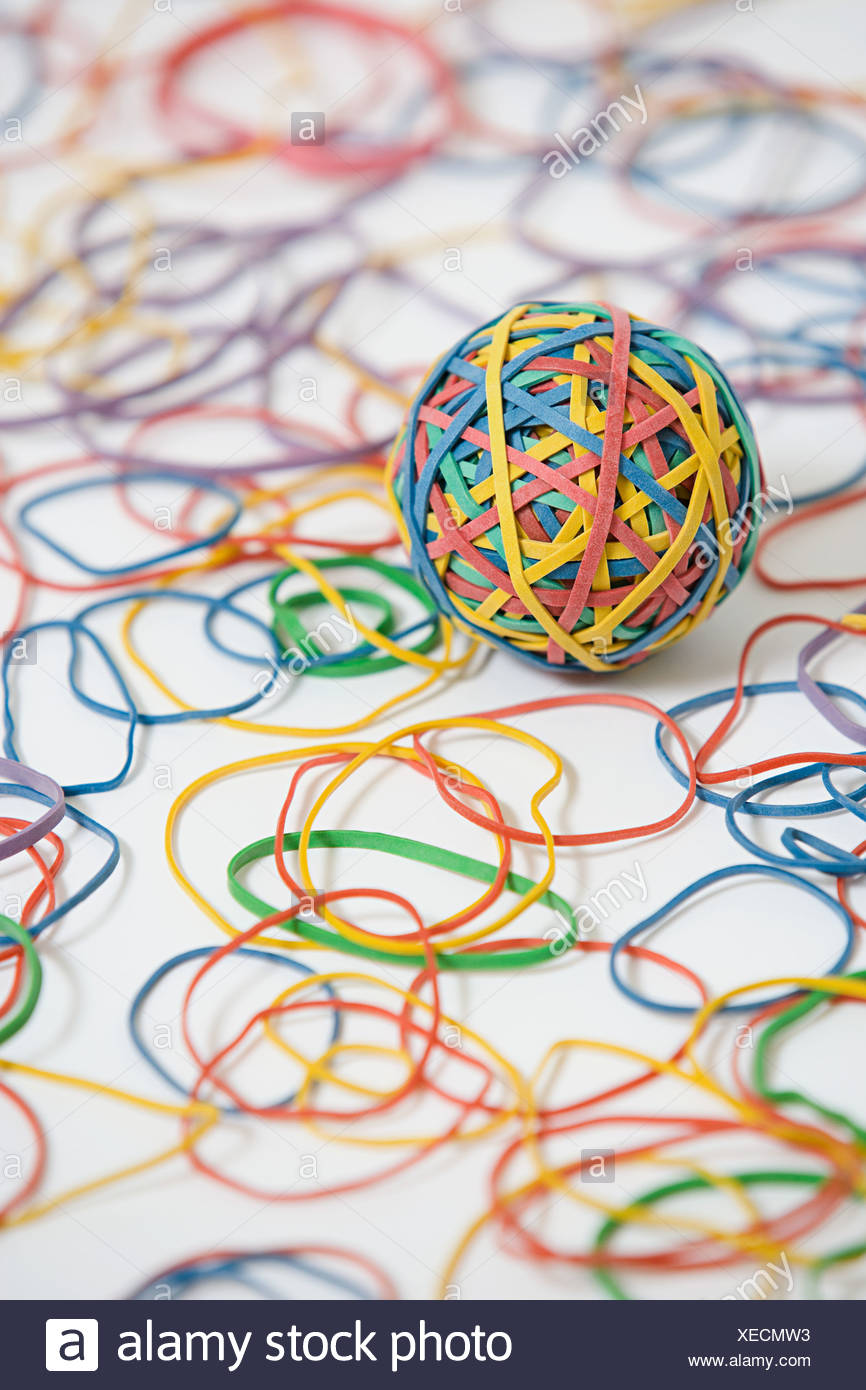 Rubber band ball and rubber bands - Stock Image