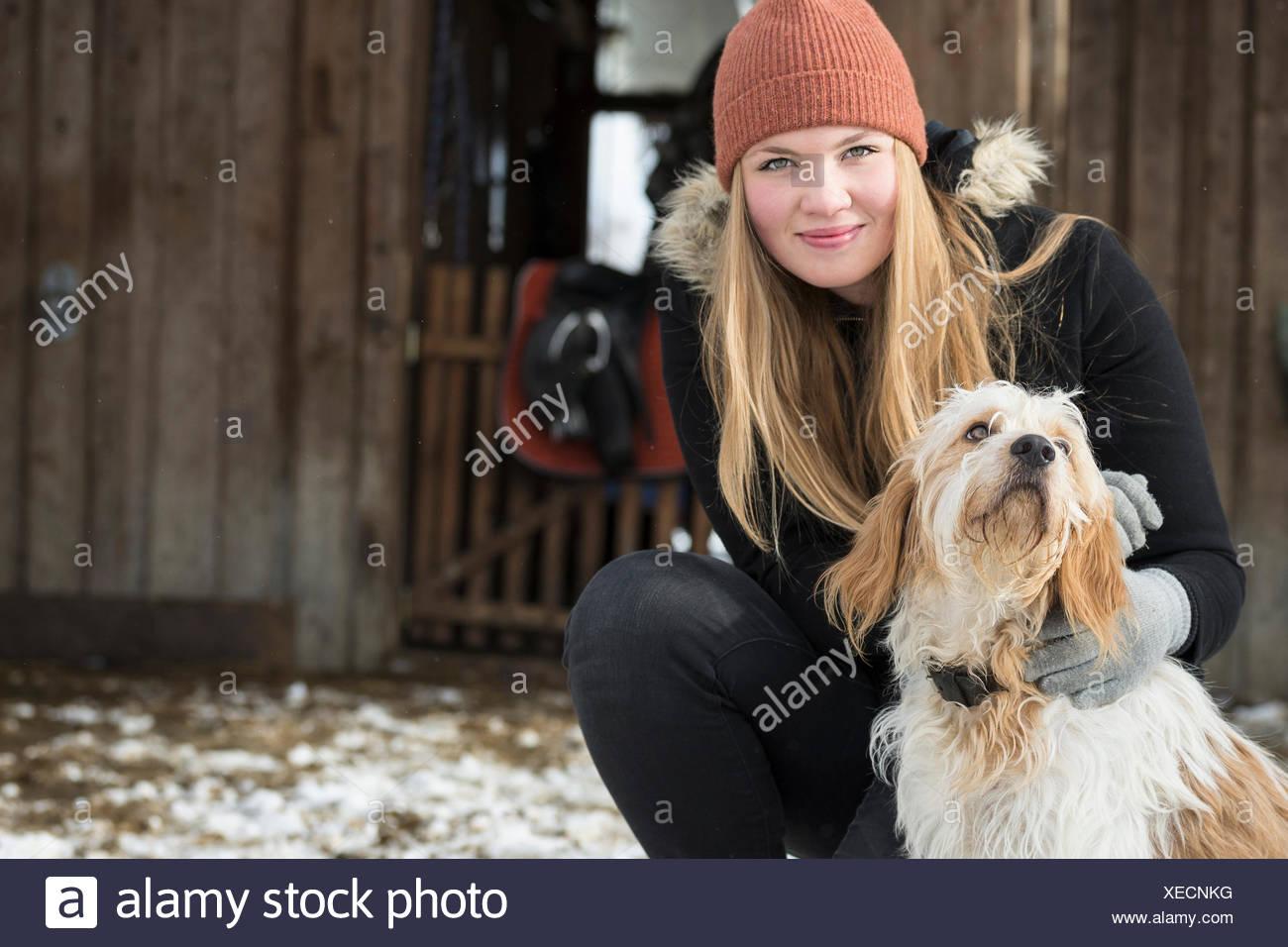Portrait of teenage girl with dog, Bavaria, Germany - Stock Image