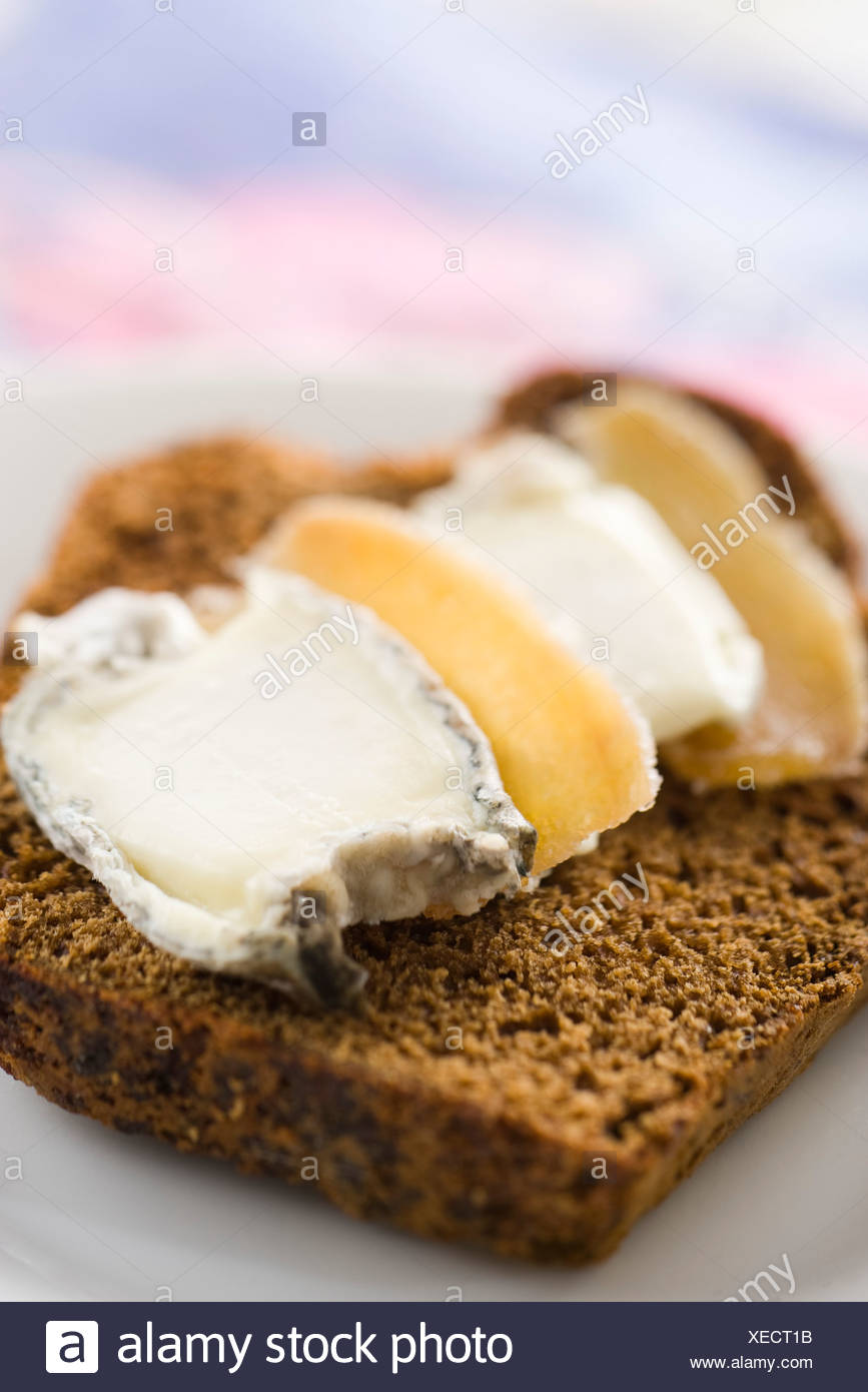 Sliced gingerbread with goat cheese and candied ginger Stock Photo